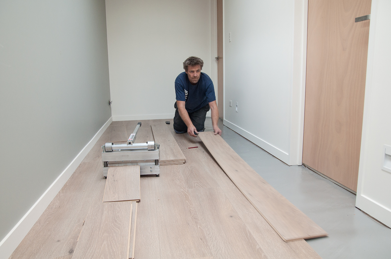 Jason Laying The Quick Step Laminate In Our Hallway