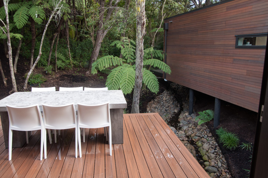 The deck behind the living pod hangs out over the stream. I took this before our Glass Vice balustrades were installed.